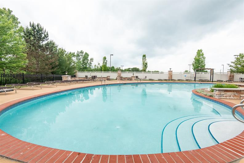 LIVE LIKE YOU ARE ALWAYS ON VACATION WITH A COMMUNITY POOL AND CLUBHOUSE