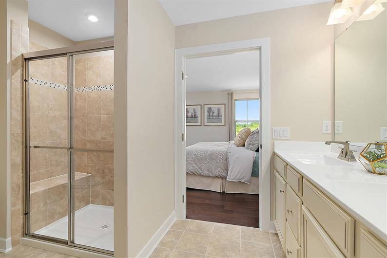 EN SUITE BATHROOMS WITH A SEATED SHOWER AND WALK-IN CLOSET