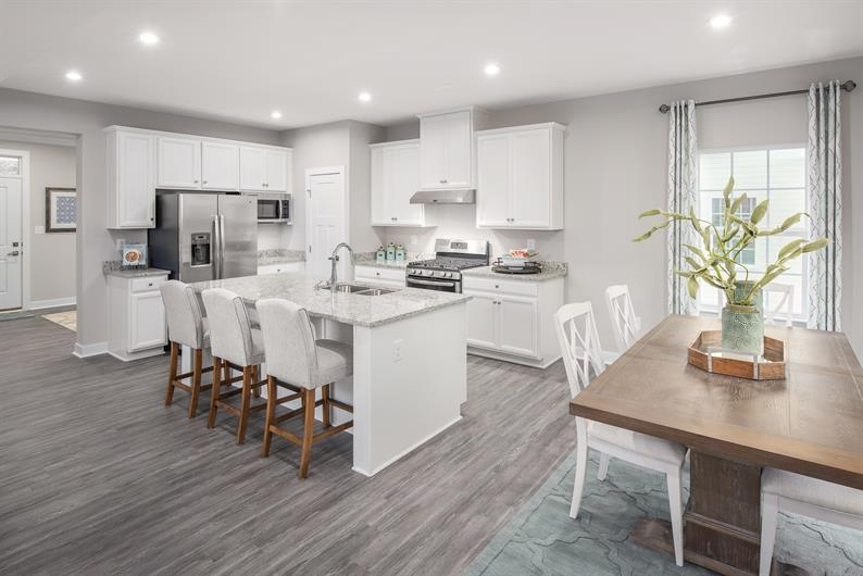 GRANITE, LUXURY VINYL PLANK FLOORING, UPGRADED WHITE CABINETS, AND MORE INCLUDED IN YOUR NEW HOME