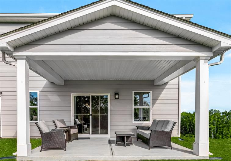 Enjoy Wooded and Pond Views from Your Covered Porch