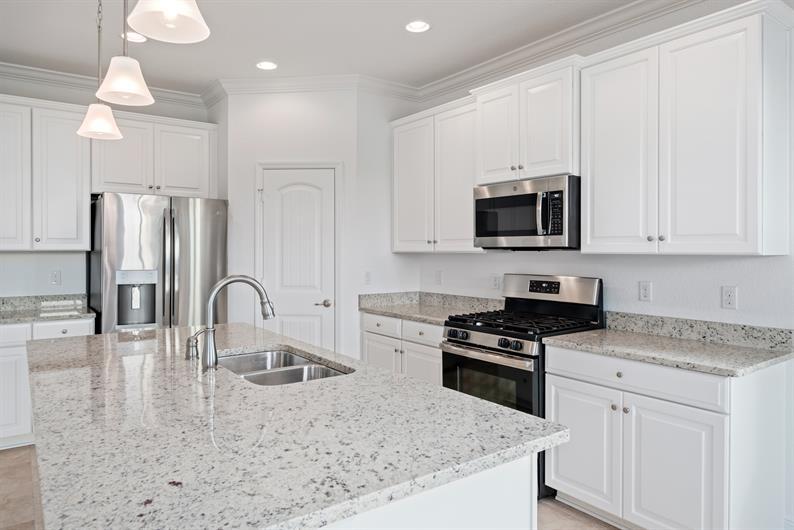 Dora Landings' homes features spacious, designer kitchens