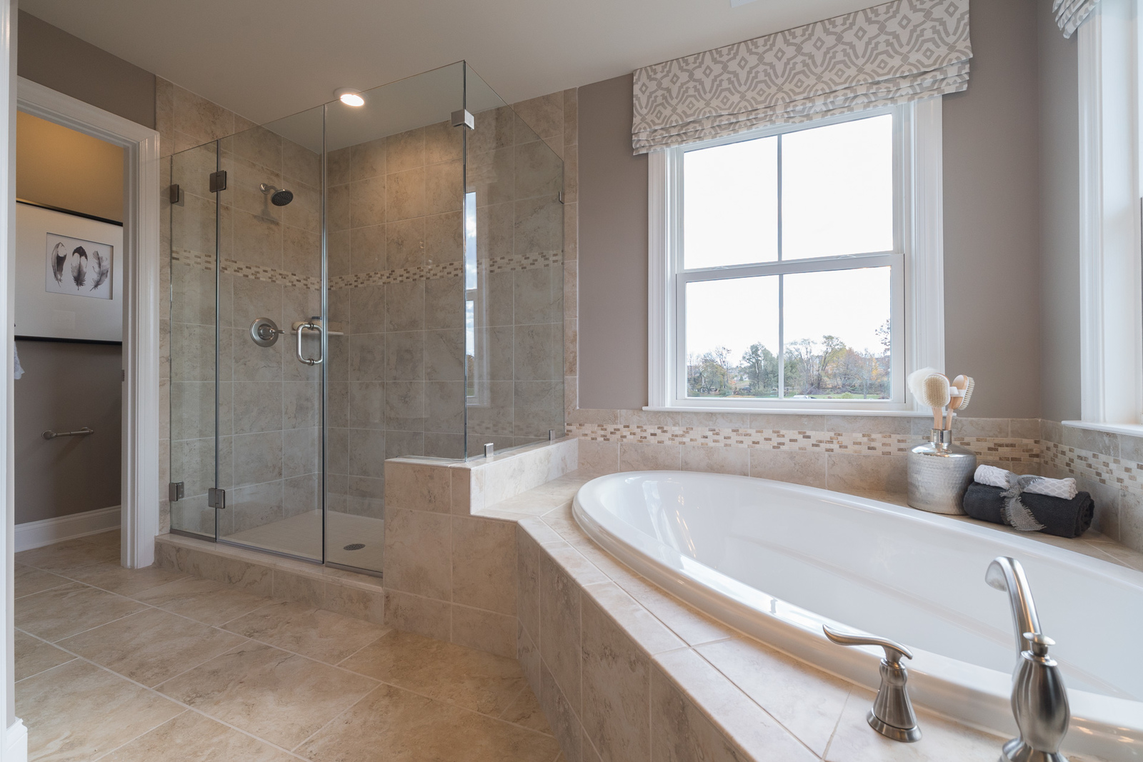 Don't settle. Have a shower and tub in your owner's suite bathroom.
