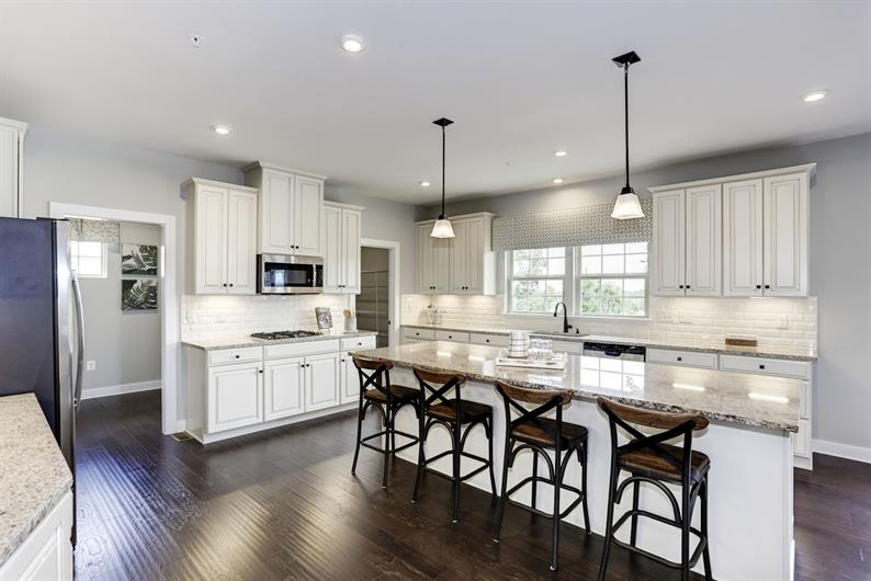 Open kitchen layouts with expansive islands