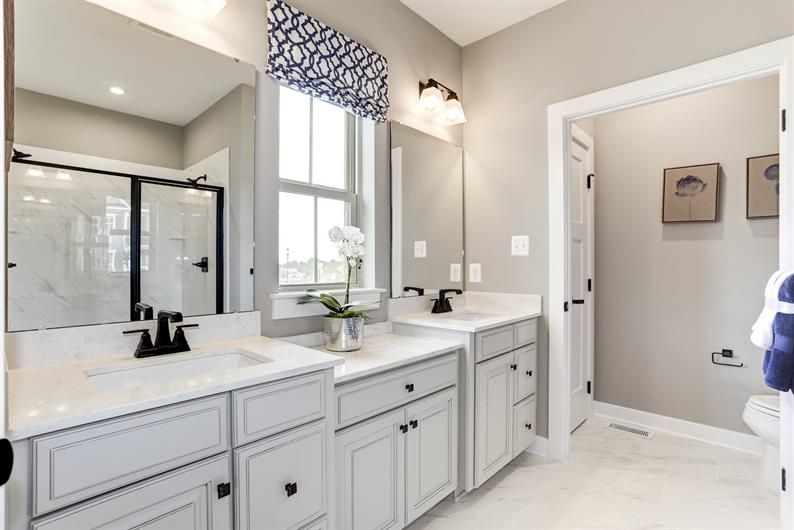 ULTIMATE RELAXATION WITH A DOUBLE VANITY AND ROMAN SHOWER