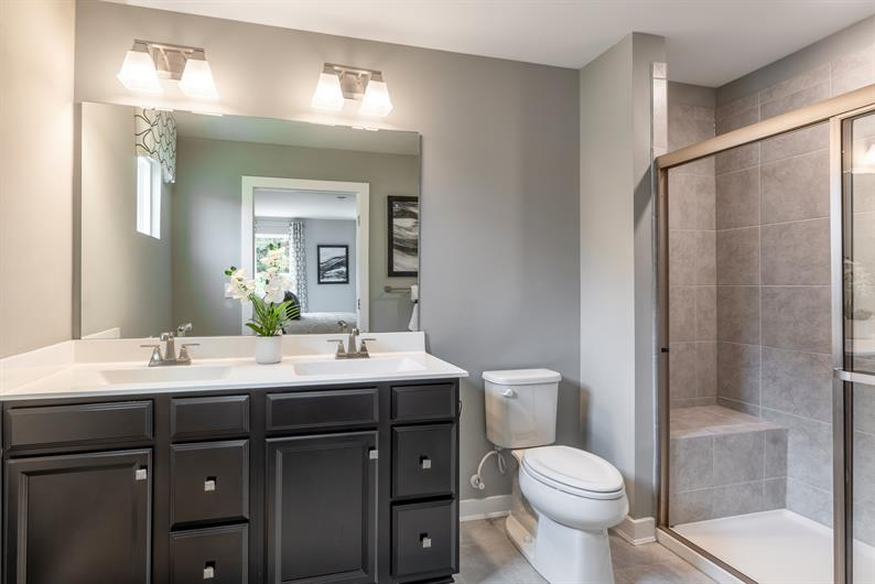 EN SUITE WITH SEATED SHOWER AND WALK-IN CLOSET
