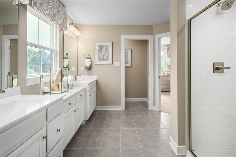 SPA WORTHY BATHROOM WITH DUAL VANITIES AND AMPLE CABINET SPACE
