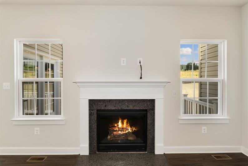 GAS FIREPLACE FLANKED BY WINDOWS