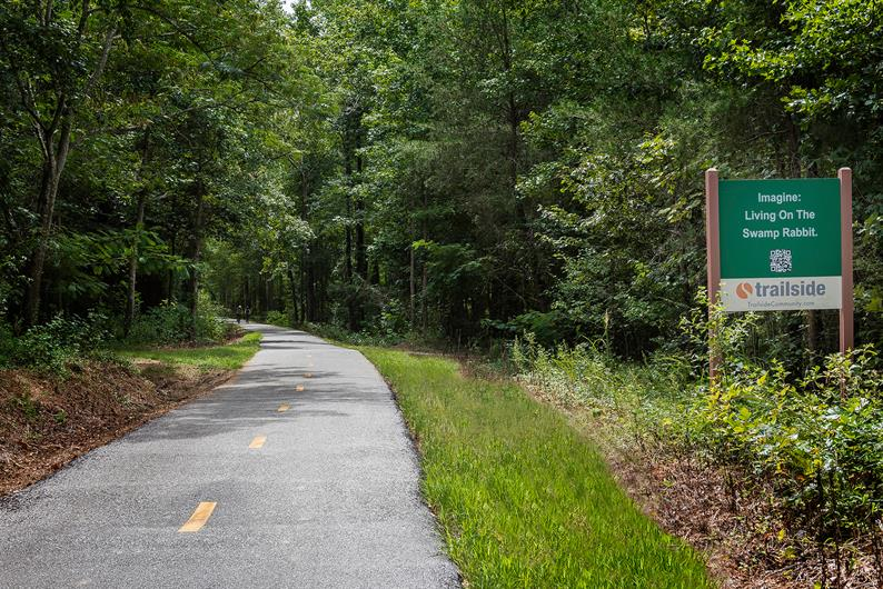 The Swamp Rabbit Trail is nearby for jogging, biking, and more