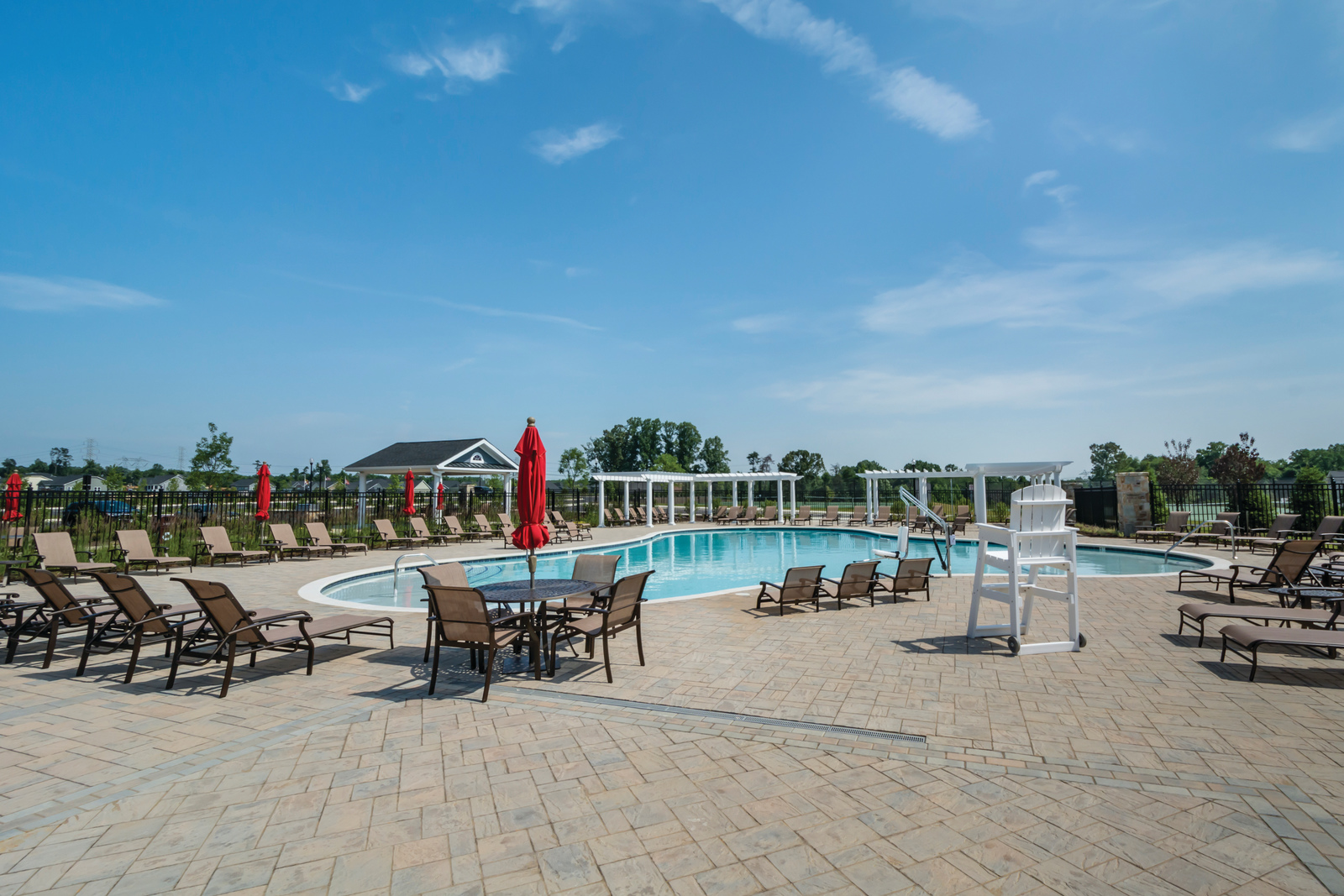 The outdoor swimming pool at Two Rivers will be the perfect destination for your visiting family.