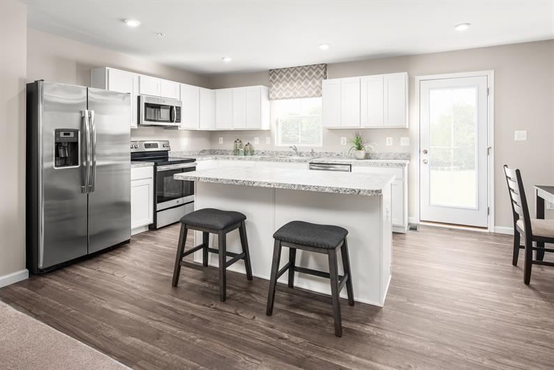 BRIGHT, OPEN KITCHENS WITH ALL KITCHEN AND LAUNDRY APPLIANCES INCLUDED