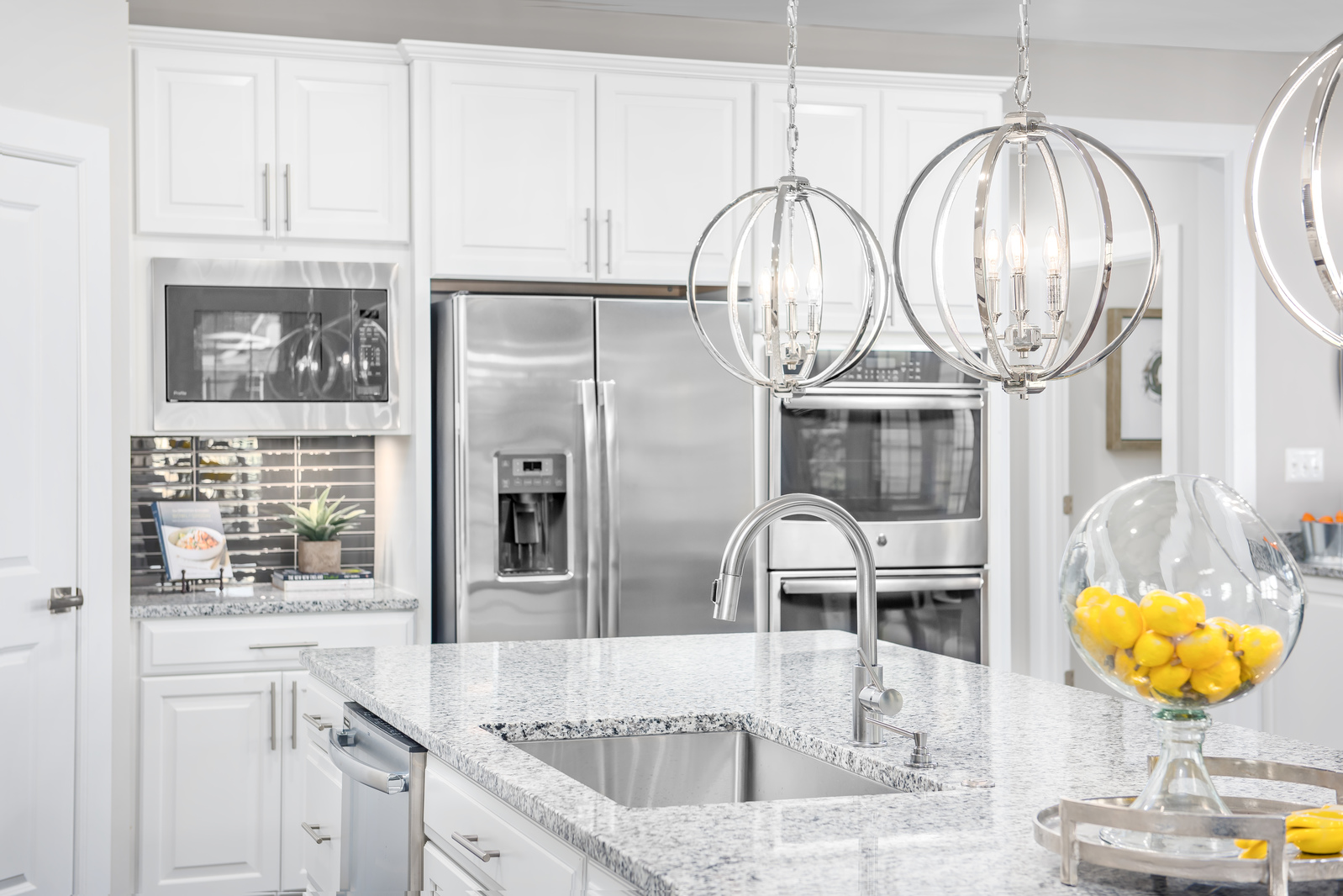 At Greystone, every executive home includes a gourmet kitchen with an oversized island, double wall oven, custom range hood and more.